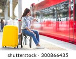young girl with luggage on the... | Shutterstock . vector #300866435