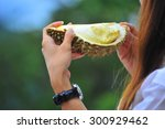 woman eating durian   Shutterstock . vector #300929462