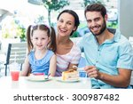 portrait of a family eating at... | Shutterstock . vector #300987482
