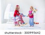 two children play indoors. kids ... | Shutterstock . vector #300995642