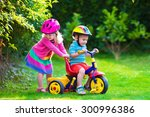 Kids Riding Bikes In A Park....