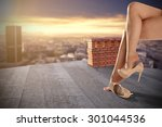 heels and woman legs on roof  | Shutterstock . vector #301044536