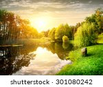 Sunset Over Calm River In The...