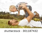 father and son playing on the... | Shutterstock . vector #301187432
