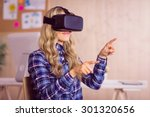 Stock photo pretty casual worker using oculus rift in her office 301320656
