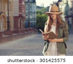 yuccie girl reading book... | Shutterstock . vector #301425575