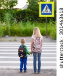 Boy And Girl Crossing The Road...