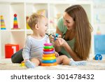 cute mother and child boy play... | Shutterstock . vector #301478432
