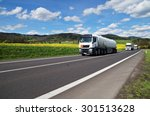 white tanker and trucks driving ... | Shutterstock . vector #301513628