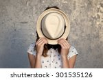 Young Girl With Hat. Hides Her...