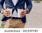 bearded man carrying coffee | Shutterstock . vector #301539785