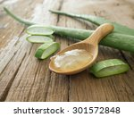 Aloe Vera Gel On Wooden Spoon...