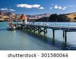 Small photo of akaroa town, new zealand in clear sky