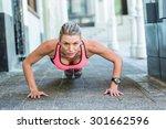 a pretty woman doing push ups... | Shutterstock . vector #301662596