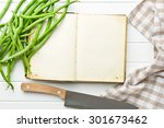 the blank recipe book and green beans - stock photo