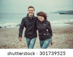 Young Couple Walking In A Good...