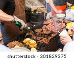 person barbecuing meat at a... | Shutterstock . vector #301829375