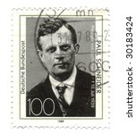 Old canceled german stamp with Paul Schneider - stock photo
