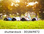 children laying on grass in park | Shutterstock . vector #301869872