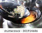 Chef Cooking Fried Rice With...