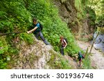 family of hikers climbing on... | Shutterstock . vector #301936748