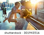 Young Mother Holding Her Baby - Fine Art prints