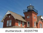 A small brick lighthouse at Sea Girt, NJ- landscape orientation