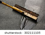 man sealing asphalt driveway | Shutterstock . vector #302111105