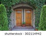 vine covered front door  | Shutterstock . vector #302114942