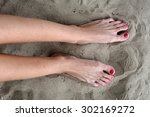 female feet with red pedicure | Shutterstock . vector #302169272