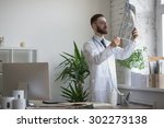 doctor working with ct scan at... | Shutterstock . vector #302273138