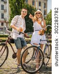 happy couple in sunglasses with ... | Shutterstock . vector #302283782