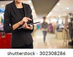 businesswoman in the shopping... | Shutterstock . vector #302308286