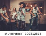 multiracial music band... | Shutterstock . vector #302312816