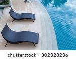 beach chairs near swimming pool ... | Shutterstock . vector #302328236