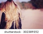 back view of the young female... | Shutterstock . vector #302389352
