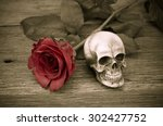 Small photo of Rose and skull on the old wooden floor, Still life, Vintage styled