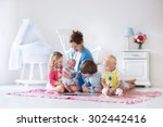 mother and children play... | Shutterstock . vector #302442416