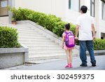 father walking to school with... | Shutterstock . vector #302459375
