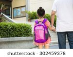 father walking to school with... | Shutterstock . vector #302459378