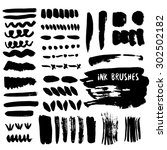 set of grunge ink brush strokes.... | Shutterstock .eps vector #302502182