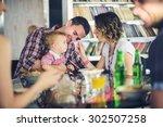child feeding on group dinner  | Shutterstock . vector #302507258