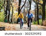urban biking   girl and boy... | Shutterstock . vector #302529392