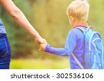 mother holding hand of little... | Shutterstock . vector #302536106