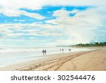 People Walking On The Beach Of...