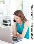 Small photo of Image of beautiful young woman having laud conversation at office desk