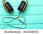 headphones on wooden background | Shutterstock . vector #302568452