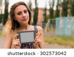 young woman using tablet ... | Shutterstock . vector #302573042
