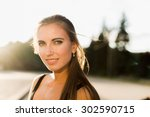 young woman using tablet ...   Shutterstock . vector #302590715