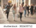 people walking down the street... | Shutterstock . vector #302635712